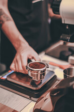 Barista Is Weighing The Roaste...