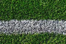 Soccer Field Texture Close Up. Grass In The Stadium. Finely Mown Lawn For Sports Grounds. Straight Lines Are Drawn In White Paint. Restrictive Zones At The Stadium.