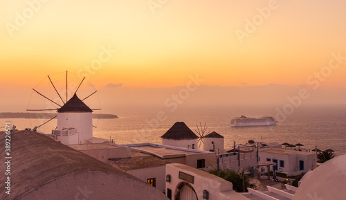 Fototapety, obrazy: Windmill and cruise ship at sunset in Oia, Santorini Island, Cyclades, Greece
