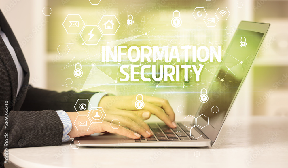 Fototapeta INFORMATION SECURITY inscription on laptop, internet security and data protection concept, blockchain and cybersecurity