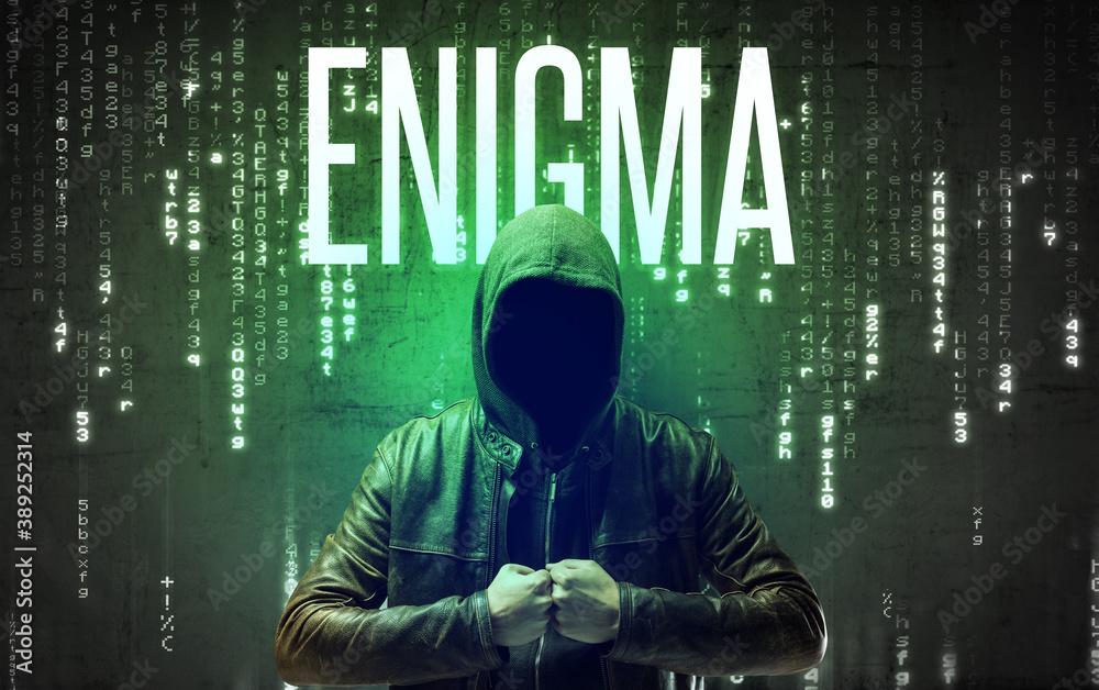 Fototapeta Faceless hacker with ENIGMA inscription, hacking concept