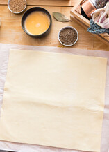 Quadrangular Puff Pastry Deployed On A Bakery Paper.