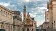 Church of Saint-Etienne-du-Mont timelapse in Paris near Pantheon. It contains shrine of St. Genevieve - patron saint of Paris. Church also contains tombs of Blaise Pascal Jean Racine. Cloudy sky at