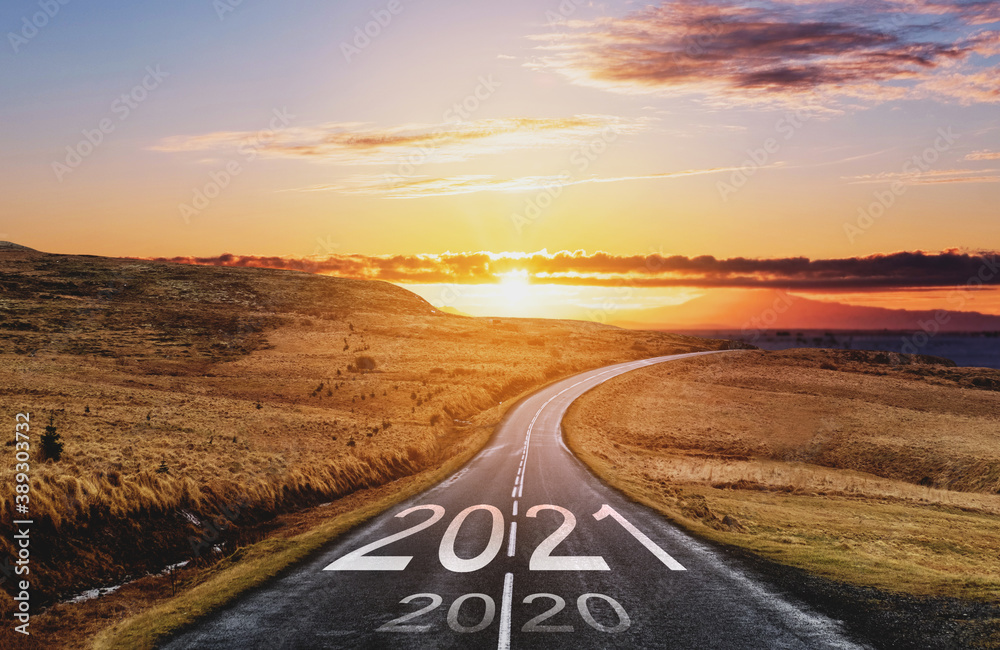 Fototapeta 2021 and 2020 on the empty road at sunset. New Year concept