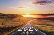 2021 And 2020 On The Empty Road At Sunset. New Year Concept