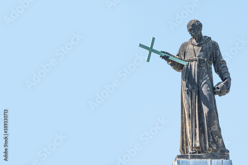 Photo Banner with old roof church statute of high ranked priest with a cross and human skull in historical downtown of Dresden, Germany, details, closeup, with copy space for text