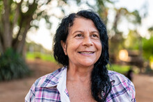 Portrait Of Smiling Beautiful Female Farmer. Woman At Farm In Summer Day. Gardening Activity. Brazilian Elderly Woman. Latino People.