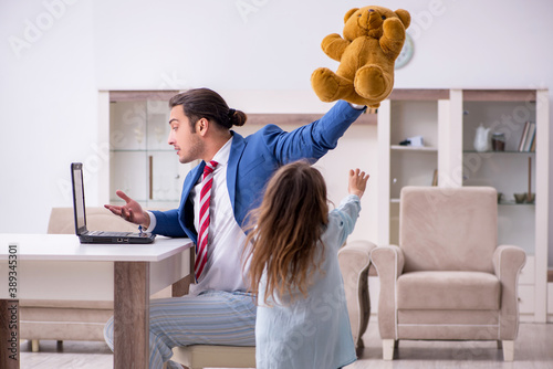 Girl bothering young father during working from house in pandemi