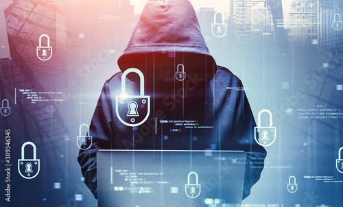 Slika na platnu Hacker with laptop in city, cyber security