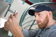 Handyman Using A Socket Wrench