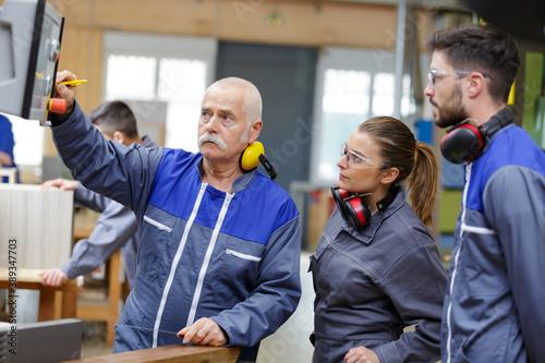 Obraz portrait of engineer training apprentices - fototapety do salonu