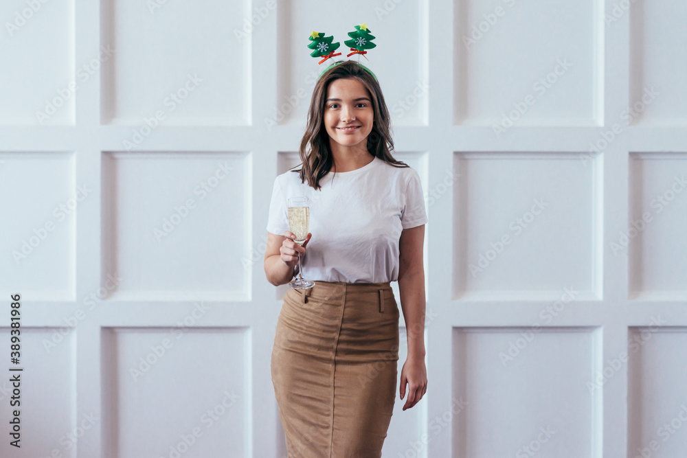 Fototapeta Portrait of young woman with glass celebrate Christmas or New Year