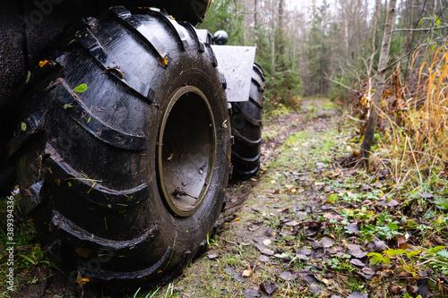 Swamp vehicle on a forest road Billede på lærred