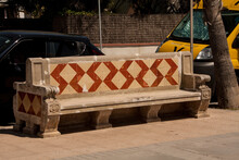 Stone Benches With Dyed Patterns Near The Road In The Daytime