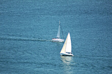 Aerial Shot Of Two Sailboats Sailing In A Calm Sea
