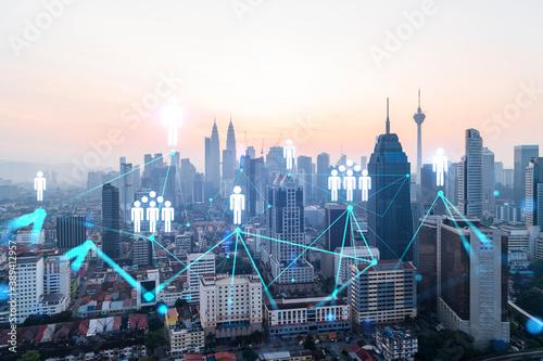 Hologram of social media icons over sunset panoramic cityscape of Kuala Lumpur, Malaysia, Asia Canvas Print