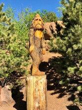 Bigfoot Statue In The Woods