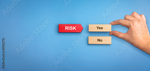 Fototapety, obrazy: Risk concept with text Yes and No. Hand holding wooden block with text Yes. Risk Management concept, Risk Management background.