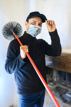Young Chimney Sweep Portrait In A House Wearing A Mask Due To Coronavirus Emergency