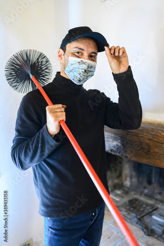 Fotografia, Obraz Young chimney sweep portrait in a house wearing a mask due to coronavirus emerge