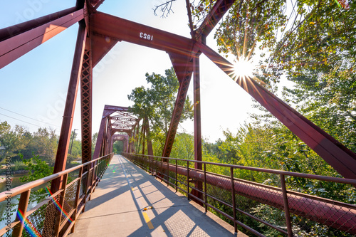 Fényképezés Popular footbridge in Boise Idaho takes one over a river