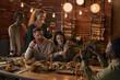 Leinwandbild Motiv Multi-ethnic group of cheerful adult people taking photo while enjoying party with outdoor lighting