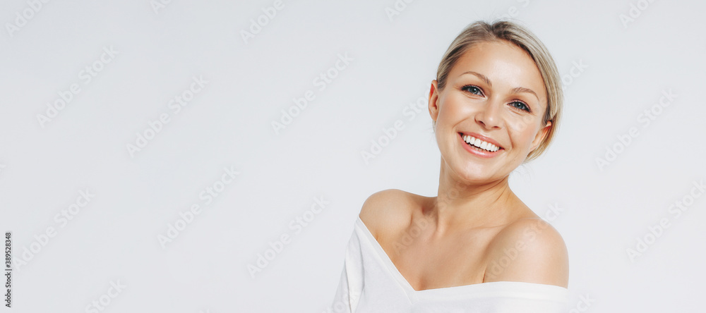 Fototapeta Beauty portrait of blonde smiling laughing woman 35 year plus clean fresh face isolated on white background