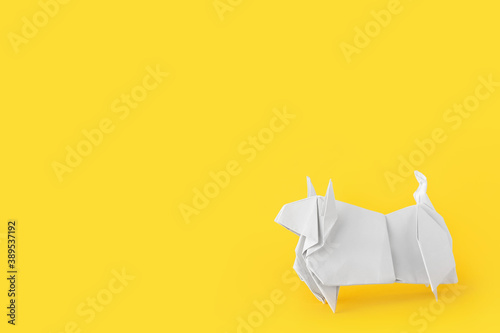 Fototapeta Origami bull as symbol of year 2021 on color background obraz