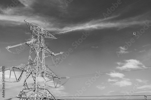 Tela electricity transmission pylon against the sky