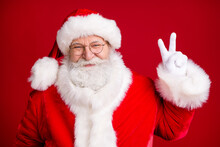 Photo Of Fairy Santa Claus Make V-sign X-mas Holly Jolly Party Wear Red Costume White Gloves Isolated Over Bright Shine Color Background