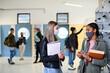 Leinwandbild Motiv Young students friends with face masks back at college or university, coronavirus concept.