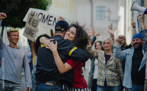 Fotografie, Obraz Police stopping group of people activists protesting on streets, women march and demonstration concept