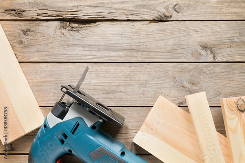 Electric jigsaw with blades on wooden table Fototapete