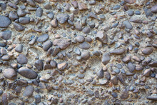 Abstract Background Consisting Of Small Pebbles Embedded In Cement