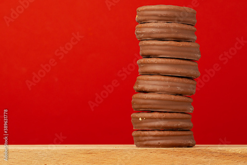 Glazed chocolate cookies stack on red background Fototapet