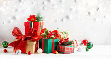 Festive Winter Composition With Christmas Gift Boxes On Table. Christmas Decorations For Holiday.