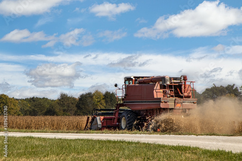 Photo Combine Harvesting Field of Soybeans