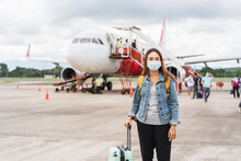 Young Woman Wearing A Face Mask At The Airport, New Normal Lifestyle Concept