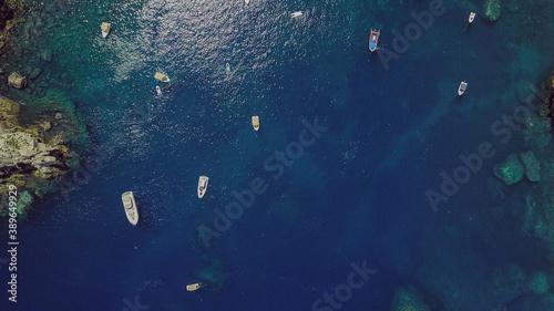 Fototapeta Drone photo of motorboats on the Mediterranean sea on the coast of Taormina in S