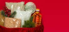 Sack Of Santa Claus With Various Groceries. Cereals, Sunflower Oil, Canned Food. Copy Space. Flat Lay.