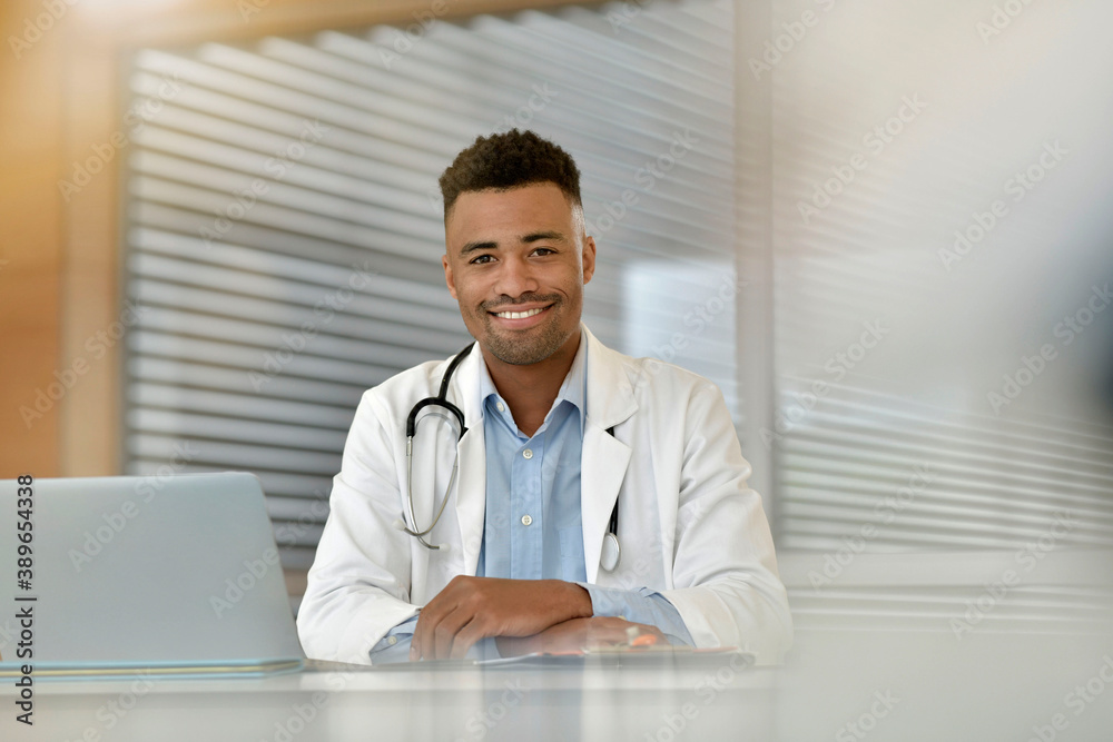 Fototapeta Portrait of smiling young medical intern working at the hospital