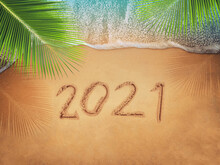Happy New Year 2021, Lettering On The Beach With Wave And Blue Sea. Numbers 2021 Year On The Sea Shore, New Years Concept.