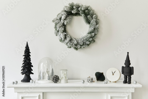 Fototapeta Christmas composition on the white chimney at the living room interior with beautiful decoration. Christmas tree and wreath, candles, stars, light. Copy space.  Template. obraz