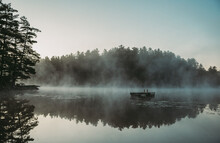 Mist Rising Off Of A Lake In T...