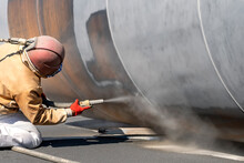 View Of The Sandblasting Or Abrasive Blasting. Abrasive Blasting, More Commonly Known As Sandblasting, Is The Operation Of Forcibly Propelling A Stream Of Abrasive Material Against A Surface.