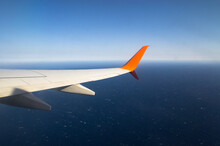 Airplane Wing Flying Over The ...