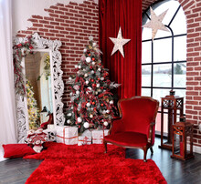 "Christmas Decoration Interior In Red With White Ornament Mirror And New Year Tree. Translation: ""Happy New Year!"""