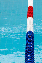 Lane Divider, Pool Marker Lines. Line Dividers Pool. Blue, Red And White. Blue Clean Water. Vertical Background.