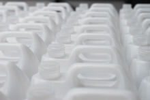 Rows Of White Plastic Canisters Ready To Be Filled With Chemicals