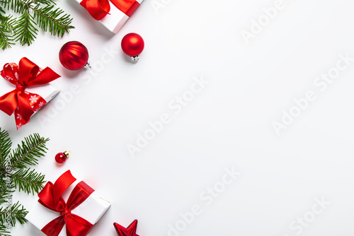 Merry Christmas and Happy Holidays greeting card, frame, banner. New Year. Noel. Red Christmas ornaments and gift on white background top view. Winter xmas holiday theme. Flat lay